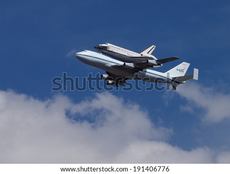 PASADENA, PASADENA/USA - SEPTEMBER 21 - The NASA space shuttle Endeavour is shown atop a Shuttle Carrier Aircraft flying over the Jet Propulsion Laboratory on September 21, 2012 in Pasadena, USA.