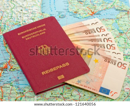 Pass with banknotes and road map - stock photo