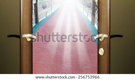 passage into the park through the old bridge door open - stock photo