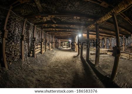 Passage through old coal mine - stock photo