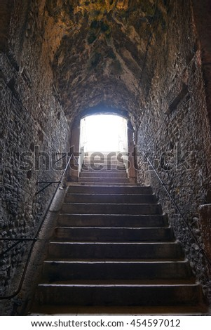 passageway in the Verona Arena with blinding sunlight, Italy.