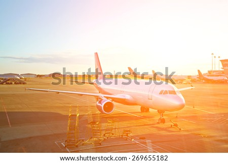 passenger aircraft at the airport getting ready for the flight - stock photo