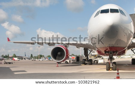 passenger aircraft is being preparing for a flight - stock photo