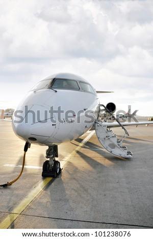 Passenger airplane charging in airport - stock photo