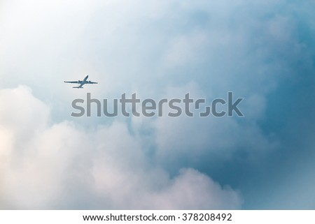 Passenger airplane in the clouds - stock photo