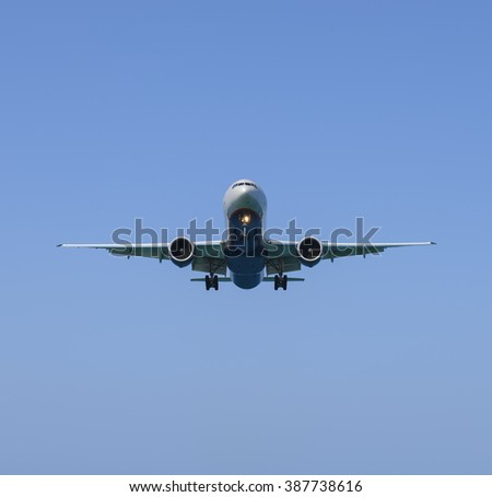 Passenger airplane just before landing - stock photo