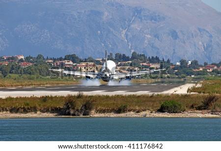 passenger airplane landing on Corfu airport - stock photo