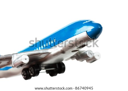 Passenger airplane toy isolated over white background. - stock photo