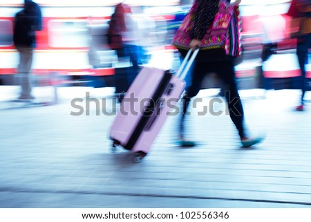 passenger at the railway station with motion blur - stock photo