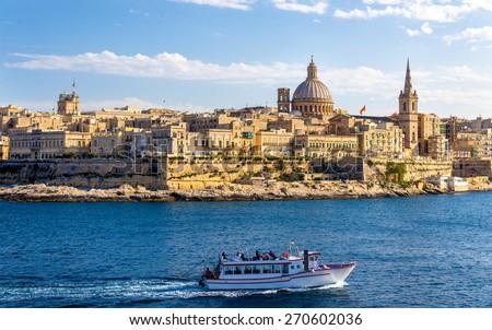 Passenger boat passing Marsamxett Harbour in Malta - stock photo