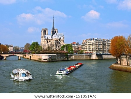 Passenger cruise at Cathedral Notre Dame, river Seine Paris France - stock photo