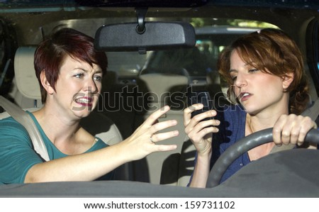 passenger frightened by reckless driver holding a cell phone - stock photo
