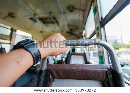 Passenger holding the handrail. - stock photo