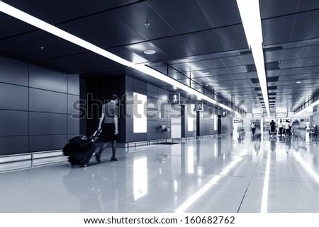 passenger in Hong Kong airport.interior of airport - stock photo