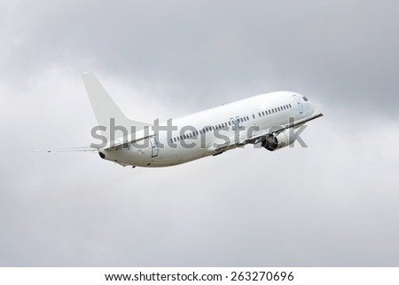 Passenger is taking off from the runway in the airport - stock photo