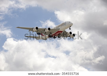 PASSENGER JET ON FINAL APPROACH TO LONDON HEATHROW AIRPORT UK - CIRCA 2015 - Emirates Airbus A380 passenger jet with landing gear down preparing to land - stock photo