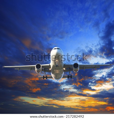passenger jet plane preparing to landing against beautiful dusky sky use for traveling industry and cargo transport business topic - stock photo