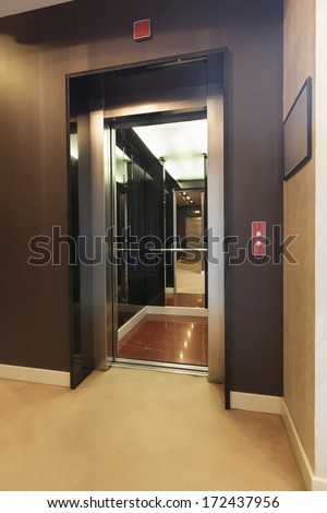 Passenger lift with open door