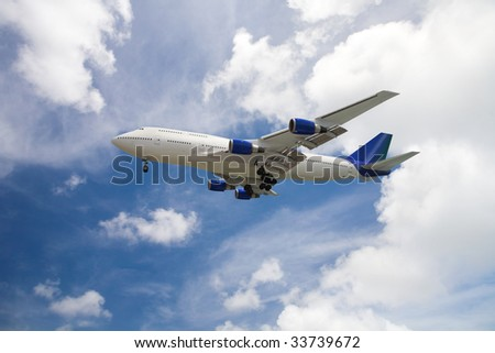 passenger plane before blue sky, clipping path included - stock photo