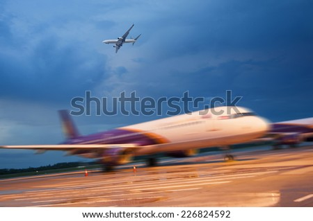 passenger plane fly up over take-off runway from airport - stock photo