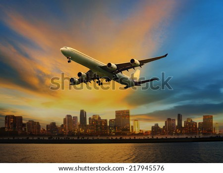 passenger plane flying above urban scene use for convenience air transport and logistic cargo by air transportation - stock photo