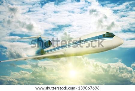 passenger plane flying in the sunny sky - stock photo