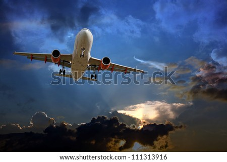 Passenger plane on final approach, against a stormy sky