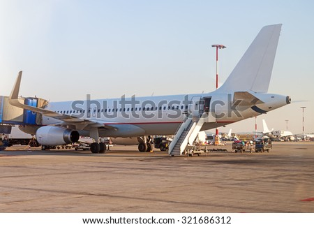 Passenger plane refueling in the airport. Aircraft maintenance.  - stock photo