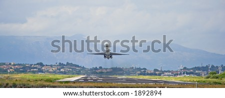 Passenger plane taking off from Corfu island airport - stock photo