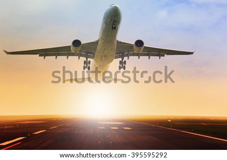 passenger plane taking over airport runway use for air transport and traveling theme - stock photo