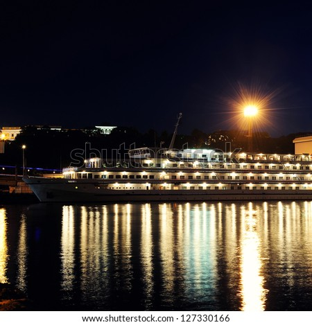 passenger ship at night in the harbor - stock photo
