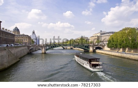 Passenger ship boat sails on the river Seine. View from the Quay. Urban scene. Paris - stock photo