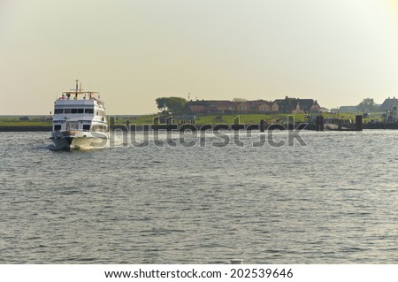 Passenger Ship in the Wadden Sea in the North Sea nearby the Hallig Hooge  in the district of north Frisia, Germany.  - stock photo