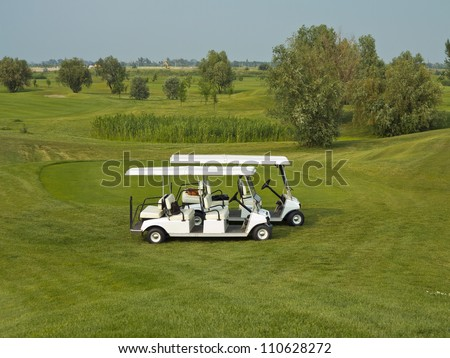 Passenger Shuttle Golf Car is compact and manageable. - stock photo