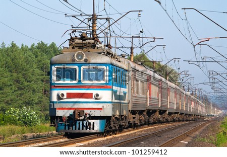Passenger train hauled by electric locomotive. Ukraine railways - stock photo