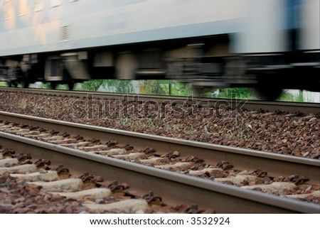 Passenger train on the track with motion blur - stock photo