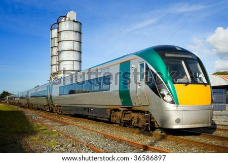 passenger train with fuel tank on background - stock photo