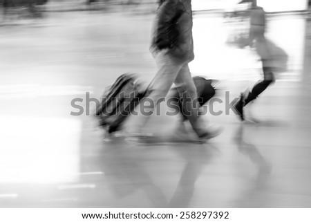 passenger walking at big city station, abstract blur. - stock photo