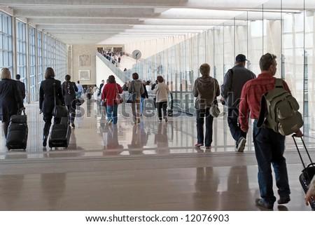 Passengers at the modern international airport - stock photo