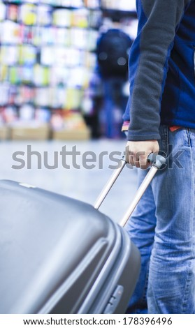 passengers dragged baggage walking on the way at airport for check in - stock photo