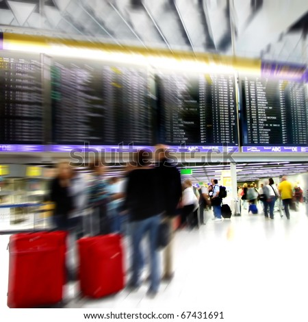 Passengers in a airport departure terminal -Motion Blur- - stock photo