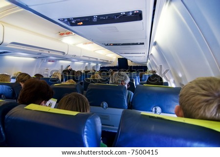 Passengers in aircraft - stock photo