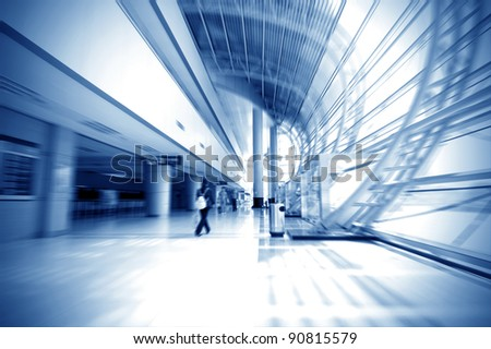 Passengers in Shanghai Pudong Airport corridor - stock photo