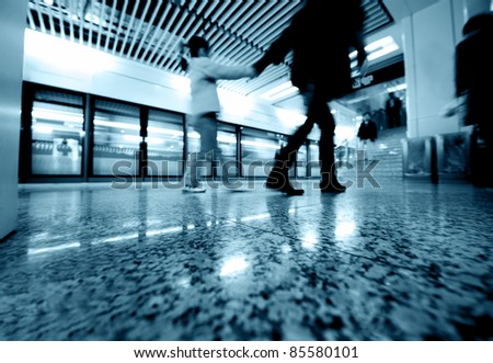 passengers in the subway station in shanghai china. - stock photo