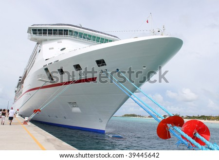 Passengers on the loading dock for a cruise ship in the clear blue Caribbean ocean of Grand Turk, Bahamas - stock photo