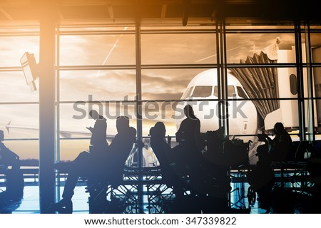 Passengers waiting at gate terminal  in Airport  - stock photo