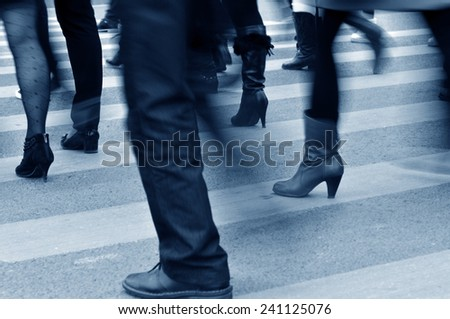 Passengers walk on the sidewalk, in Shanghai, China