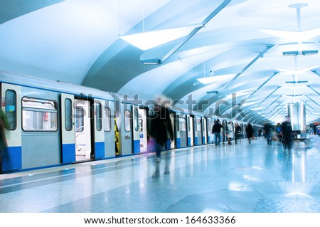Passengers walk out from metro train - stock photo