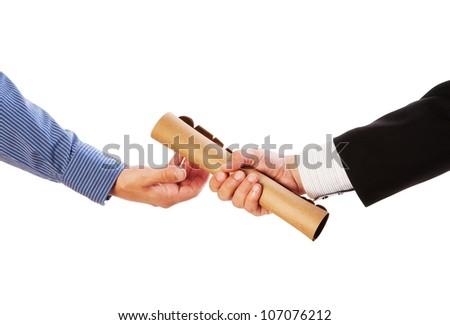 Passing the baton -Partnership or teamwork concept two men handing over a paperwork baton - stock photo