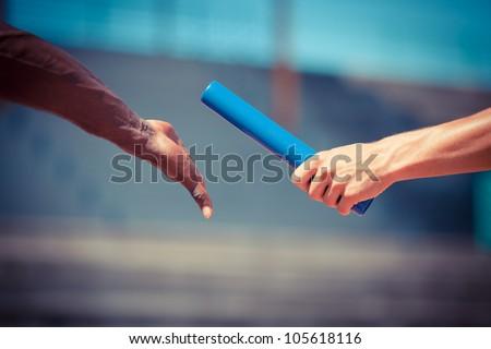Passing the Relay Baton - stock photo